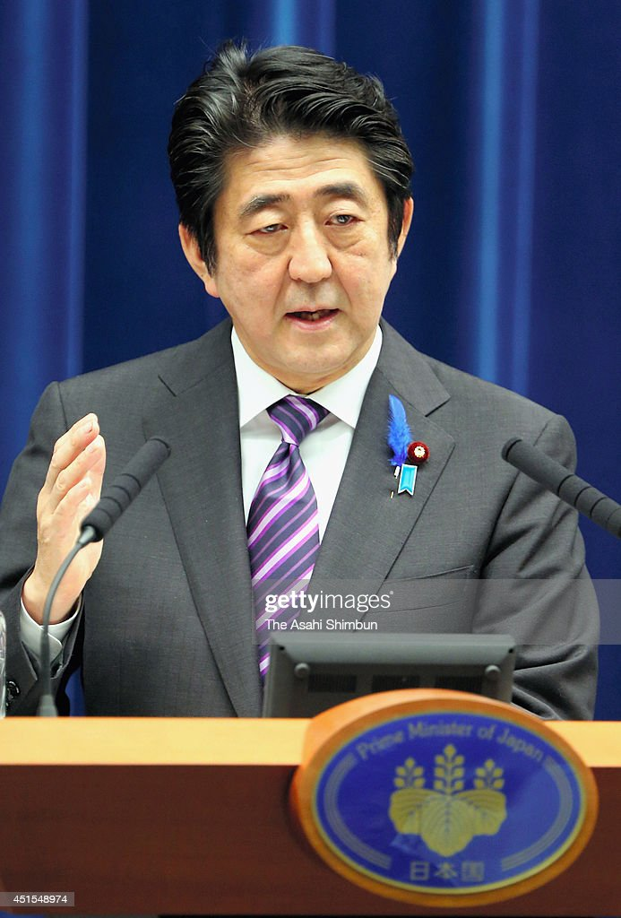Prime Minister Shinzo Abe speaks at a news conference after the Cabinet approved a document that changes the government's interpretation of the...