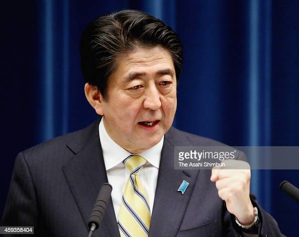 Prime Minister Shinzo Abe speaks during a press conference after dissolving the lower house at his official residence on November 21 2014 in Tokyo...
