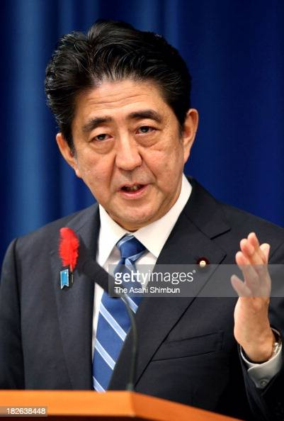 Prime Minister Shinzo Abe speaks during a press conference on the consumption tax rate hike at his official residence on October 1 2013 in Tokyo...