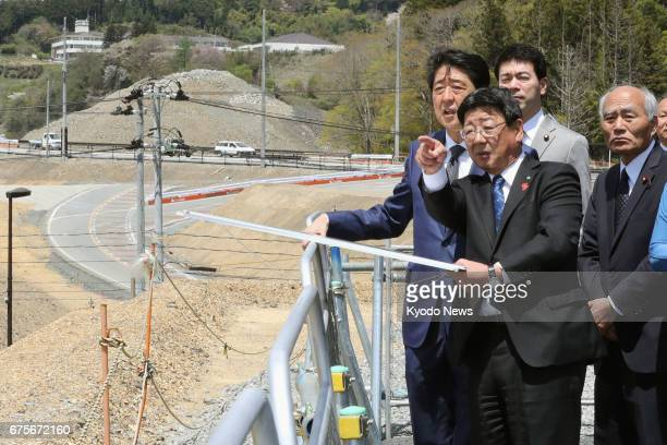 Prime Minister Shinzo Abe visits the northeastern Japan town of Minamisanriku devastated by the March 2011 earthquake and tsunami on May 2 to inspect...