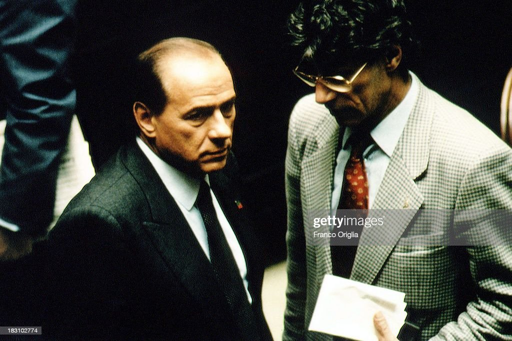 Prime Minister <a gi-track='captionPersonalityLinkClicked' href=/galleries/search?phrase=Silvio+Berlusconi&family=editorial&specificpeople=201842 ng-click='$event.stopPropagation()'>Silvio Berlusconi</a> (L) and <a gi-track='captionPersonalityLinkClicked' href=/galleries/search?phrase=Umberto+Bossi&family=editorial&specificpeople=613296 ng-click='$event.stopPropagation()'>Umberto Bossi</a> of 'Lega Nord' at the Chamber of Deputies during the opening of the Parliamentary session at Montecitorio on April 12, 1994 in Rome, Italy.