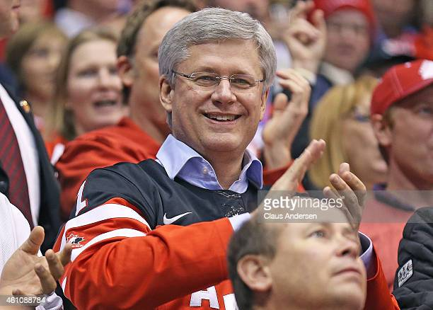 Prime Minister Stephen Harper takes in the action between Team Canada and Team Russia during the Gold medal game in the 2015 IIHF World Junior Hockey...