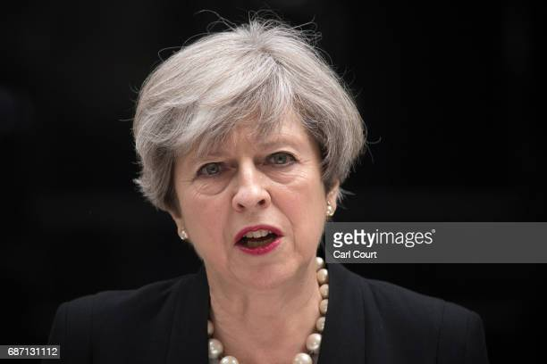 Prime Minister Theresa May addresses the media as she makes a statement in Downing Street following a COBRA meeting to discuss the government's...