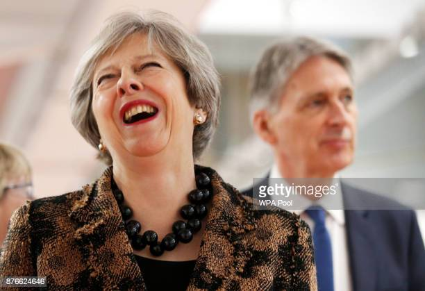 Prime Minister Theresa May and Chancellor of the Exchequer Philip Hammond visit an engineering training facility on November 20 2017 in Birmingham...