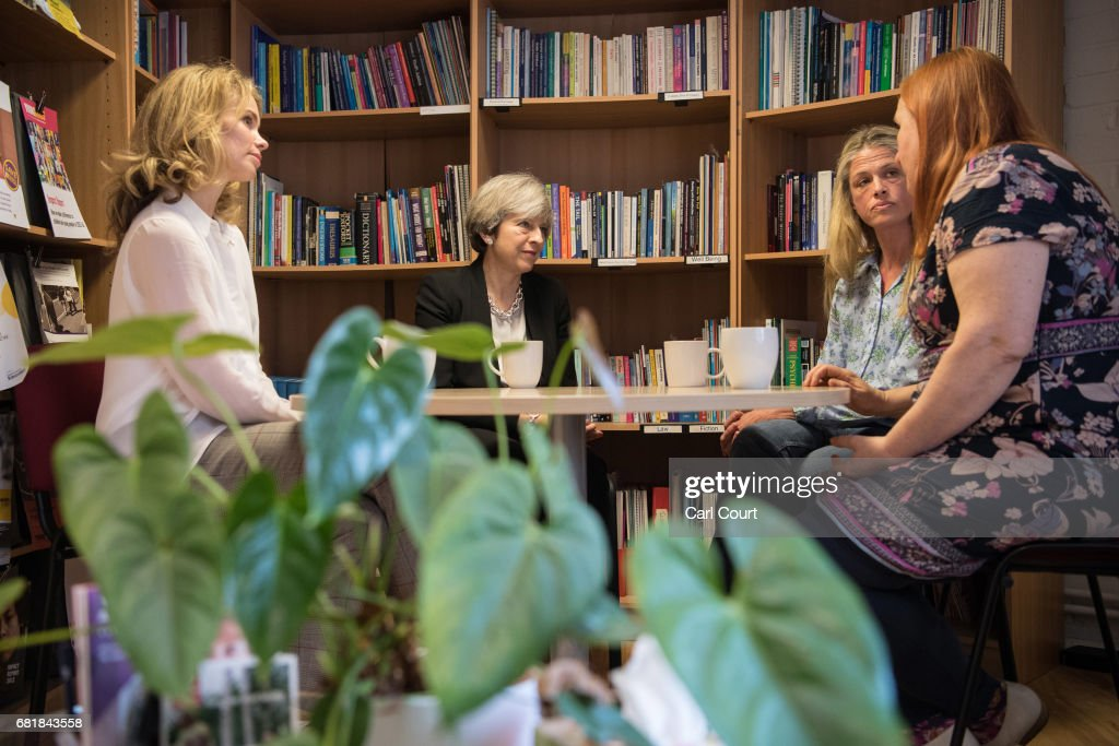 Prime Minister Theresa May (C-L) and Conservative parliamentary candidate for Bermondsey & Old Southwark, Siobhan Baillie (L), meet staff members during a visit to the Young Minds mental health charity on May 11, 2017 in London, England. Campaigning continued by all parties today ahead of the June 8th general election.