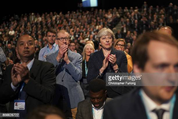 Prime minister Theresa May and her husband Philip applaud after Chancellor of the Exchequer Phillip Hammond delivered his keynote speech on day two...