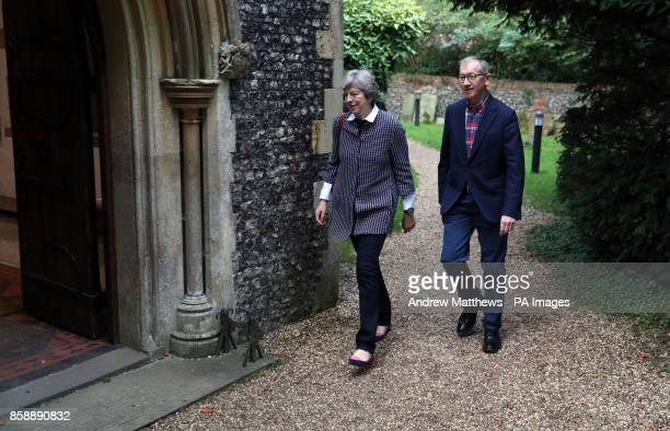 Prime Minister Theresa May and her husband Philip attend a service at St Andrew's Church in Sonning Berkshire