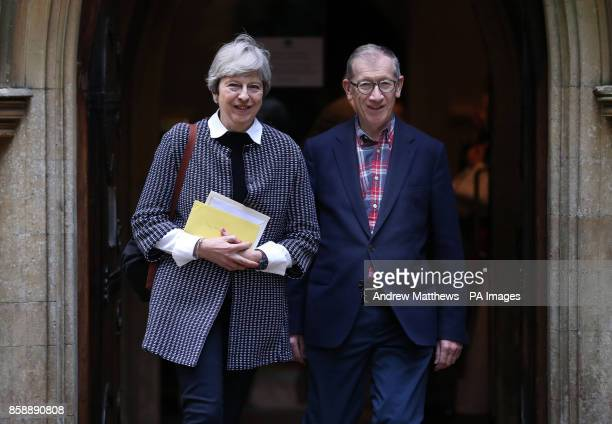 Prime Minister Theresa May and her husband Philip leave after attending a service at St Andrew's Church in Sonning Berkshire