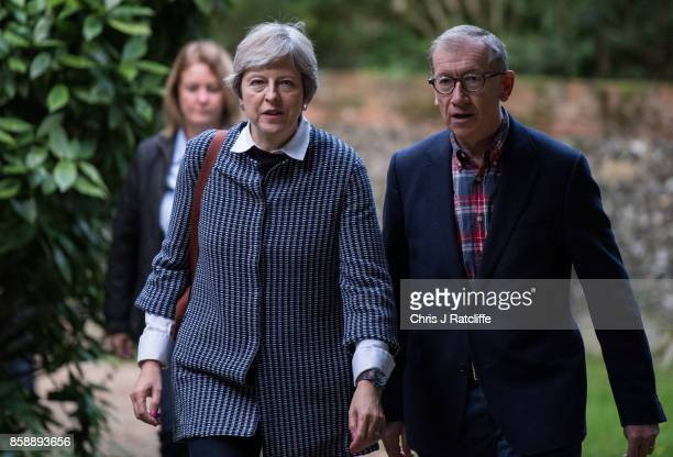 Prime Minister Theresa May arrives at St Andrew's Church for Sunday morning mass with her husband Philip May in her constiituency of Maidenhead on...
