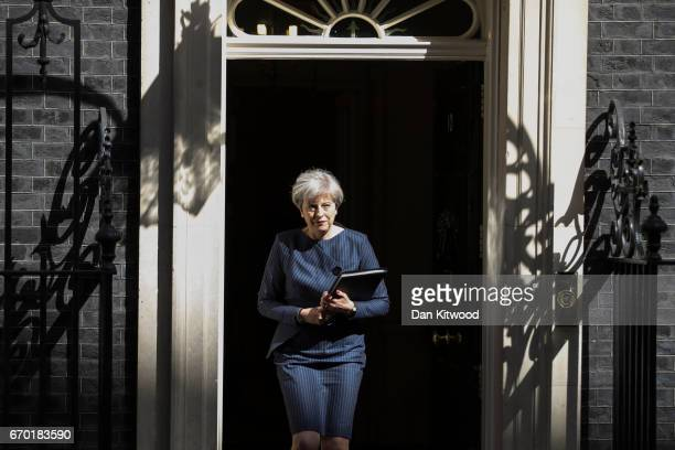 Prime Minister Theresa May arrives to make a statement to the nation in Downing Street on April 18 2017 in London United Kingdom The Prime Minister...