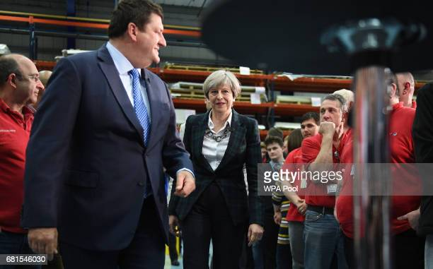 Prime Minister Theresa May arrives to speak to an assembled crowd during a general election campaign event at marketing services group Linney on May...