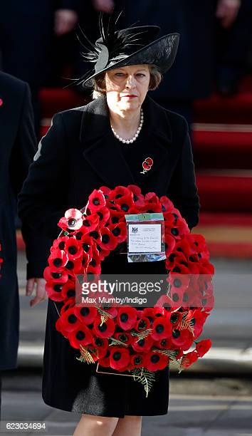 Prime Minister Theresa May carries her wreath as she attends the annual Remembrance Sunday Service at the Cenotaph on Whitehall on November 13 2016...