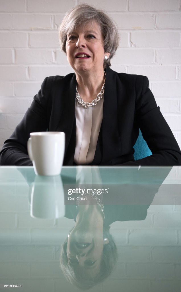 Prime Minister Theresa May chats with youth activists during a visit to the Young Minds mental health charity on May 11, 2017 in London, England. Campaigning continued by all parties today ahead of the June 8th general election.
