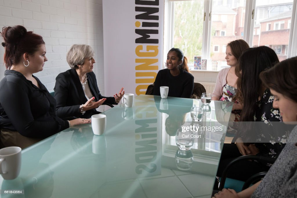 Prime Minister Theresa May (1-L) chats with youth activists during a visit to the Young Minds mental health charity on May 11, 2017 in London, England. Campaigning continued by all parties today ahead of the June 8th general election.