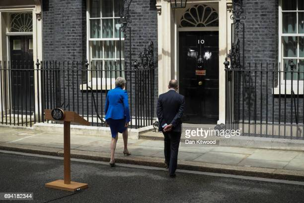 Prime Minister Theresa May enters 10 Downing Street with husband Philip after speaking on June 9 2017 in London England After a snap election was...