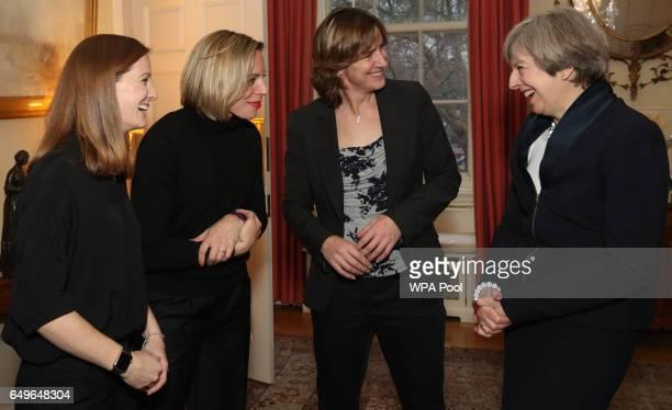 Prime Minister Theresa May greets Katherine Grainger Kate RichardsonWalsh and Helen RichardsonWalsh during an International Women's Day reception at...