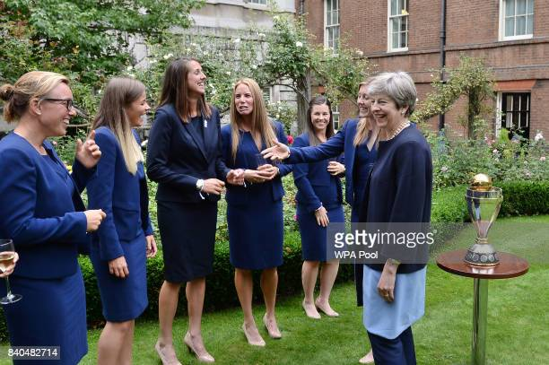 Prime Minister Theresa May greets members of the England Women's Cricket team at a reception at 10 Downing Street on August 29 2017 in London England...