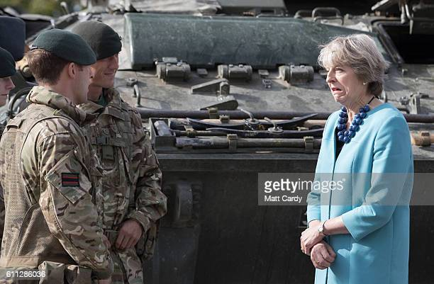Prime Minister Theresa May greets troops as she visits 1st Battalion The Mercian Regiment at their barracks at Bulford Camp on September 29 2016 near...