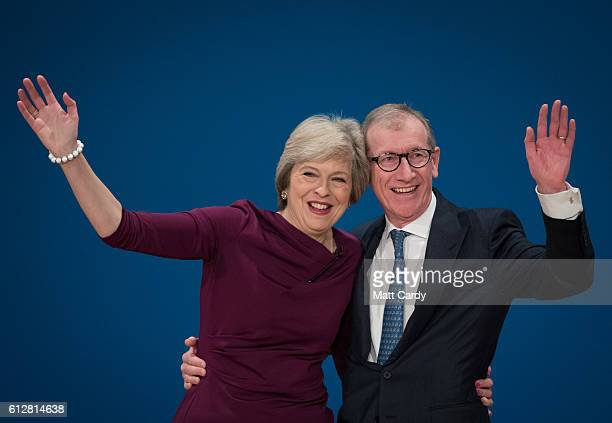Prime Minister Theresa May is joined on stage by her husband Philip after she made her keynote speech as she closes the 2016 Conservative Conference...
