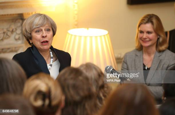 Prime Minister Theresa May is seen alongside Justine Greening as she addresses the attendees of an International Women's Day reception at 10 Downing...
