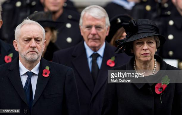 Prime Minister Theresa May Jeremy Corbyn and John Major during the annual Remembrance Sunday memorial on November 12 2017 in London England The...