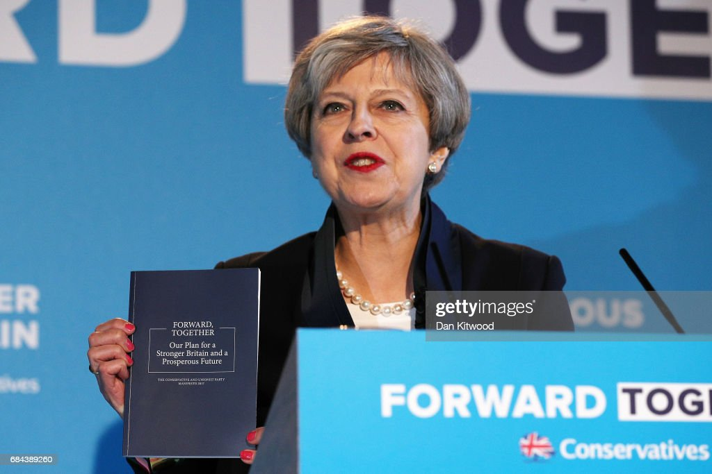 Prime Minister Theresa May launches the Conservative Party Election Manifesto, on May 18, 2017 in Halifax, United Kingdom. The Conservative Party Election Manifesto contains major reforms to social care, ditching the pensions triple-lock and scrapping free school lunches in favour of free primary school breakfasts. Britain will vote in a general election on June 8.