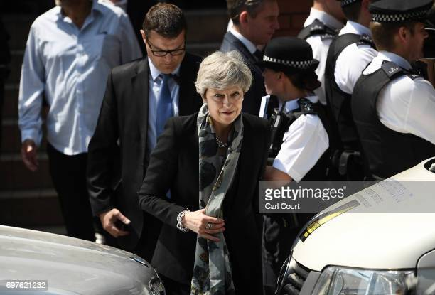 Prime Minister Theresa May leaves after visiting Finsbury Park mosque near the scene of a terror attack in the early hours of this morning on June 19...