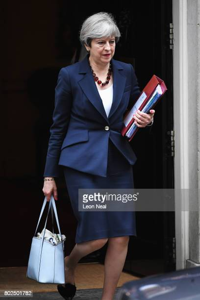 Prime Minister Theresa May leaves Downing Street on her way to attending Prime Minister's Questions in the Houses of Parliament on June 28 2017 in...