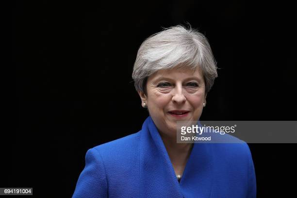 Prime Minister Theresa May leaves Downing Street to go to Buckingham Palace where she will seek the Queen's permission to form a UK government on...