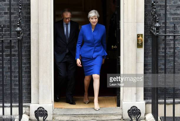 Prime Minister Theresa May leaves Downing Street with her husband Philip to go to Buckingham Palace where she will seek the Queen's permission to...