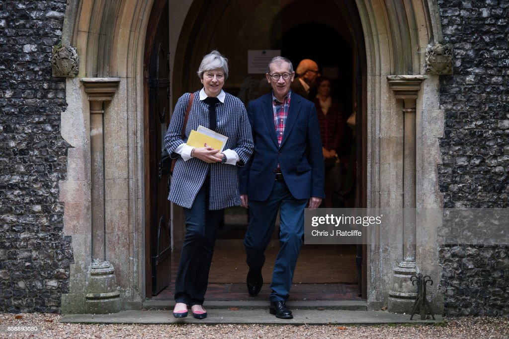 Prime Minister Theresa May leaves St. Andrew's Church after Sunday morning mass with her husband Philip May in her constiituency of Maidenhead on October 8, 2017 in Sonning, England. The Prime Minister lives near the church and has been at her constituency home over the weekend.