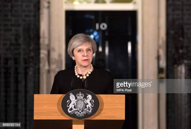 Prime Minister Theresa May makes a statement in Downing street following the terrorist incident in westminster on March 22 2017 in London England...