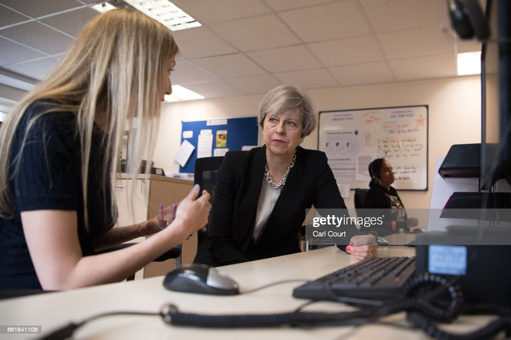 Prime Minister Theresa May (R) meets a helpline advisor during a visit to the Young Minds mental health charity on May 11, 2017 in London, England. Campaigning continued by all parties today ahead of the June 8th general election.
