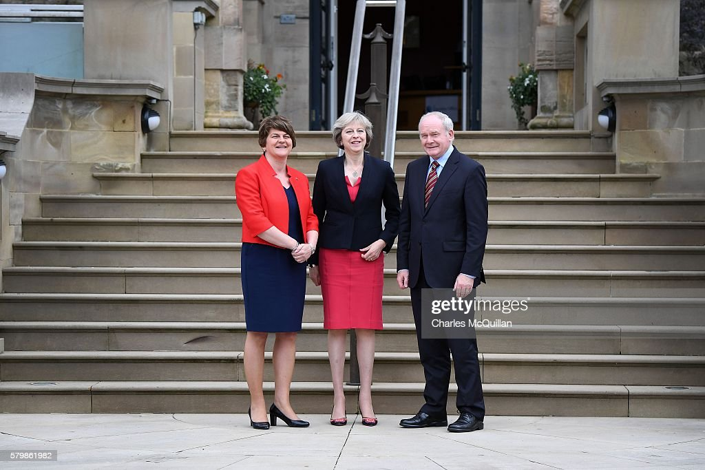 Prime Minister Theresa May (C) meets Northern Ireland first minister Arlene Foster (L) and deputy first minister Martin McGuinness (R) at Stormont Castle on July 25, 2016 in Belfast, Northern Ireland. The meeting follows similar ministerial meetings in Scotland and Wales since Mrs May's appointment. Brexit and the matter of the border between Northern Ireland and the Republic of Ireland, the United Kingdom's only hard border with the EU will be high on the agenda during todays talks.