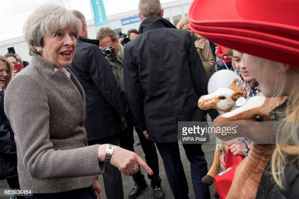 Prime Minister Theresa May meets visitors at the Balmoral Show during a general election campaign visit on May 13 in Lisburn Northern Ireland Britain...