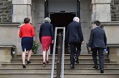 Prime Minister Theresa May Northern Ireland first minister Arlene Foster deputy first minister Martin McGuinness and NI secretary of state James...