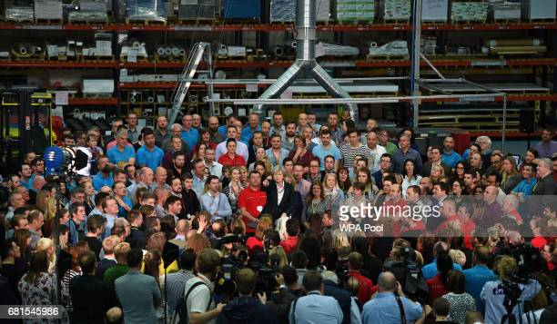Prime Minister Theresa May points as she speaks to an assembled crowd during a general election campaign event at marketing services group Linney on...