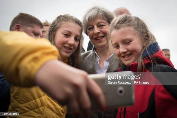 Prime Minister Theresa May poses for a selfie at the Balmoral Show near Lisburn in Northern Ireland where she toured the exhibition stands and met...