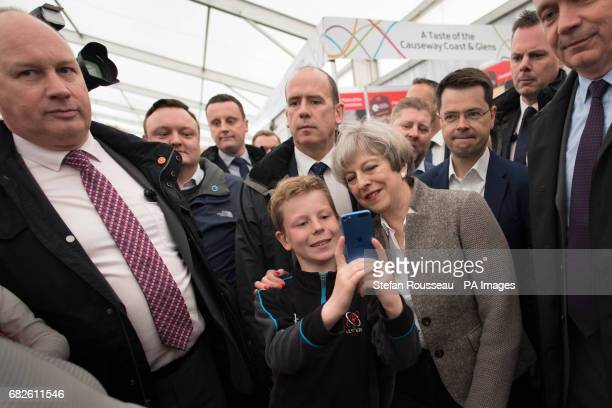 Prime Minister Theresa May poses for a selfie while visiting the Balmoral Show near Lisburn in Northern Ireland where she toured the exhibition...