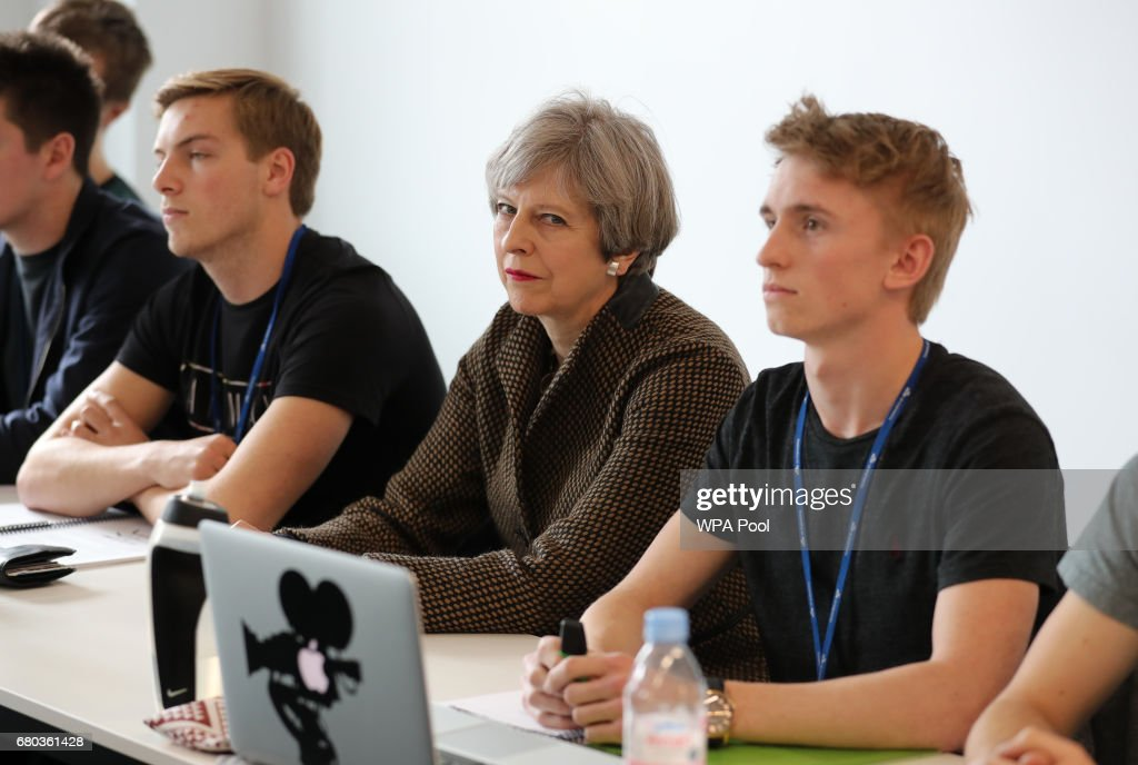 Prime Minister Theresa May sits in a classroom with students during a visit to the International Aviation Academy in Norwich on May 8, 2017 in Norwich, Norfolk, England. Theresa May is today campaigning in London and the East of England ahead of the June 8th general election.