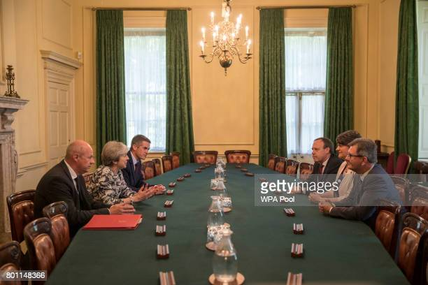Prime Minister Theresa May sits with First Secretary of State Damian Green and Parliamentary Secretary to the Treasury and Chief Whip Gavin...