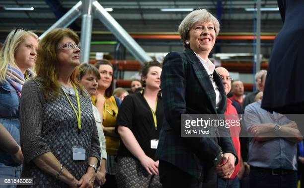 Prime Minister Theresa May smiles during a general election campaign event at marketing services group Linney on May 10 2017 in Scunthorpe England...