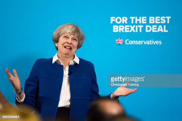 Prime Minister Theresa May speaks at a campaign rally at The Grand Station on May 30 2017 in Wolverhampton England Britain goes to the polls on June...