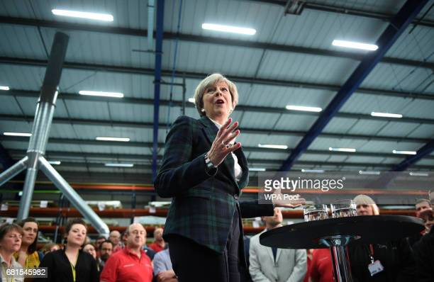 Prime Minister Theresa May speaks to an assembled crowd during a general election campaign event at marketing services group Linney on May 10 2017 in...