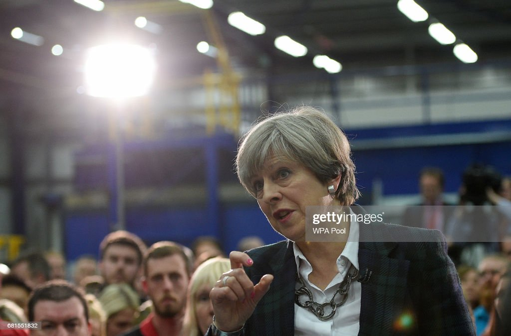 Prime Minister Theresa May (C) speaks to an assembled crowd during a general election campaign event at marketing services group Linney on May 10, 2017 in Scunthorpe, England. Campaigning is underway ahead of the general election which is to be held on June 8th.
