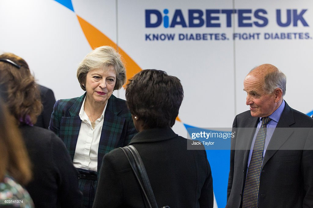 Prime Minister Theresa May (L) speaks to Diabetes UK volunteers and staff members at their new office on November 14, 2016 in London, England. Mrs May, who was diagnosed with Type 1 diabetes while Home Secretary, officially launches the new Diabetes UK office today to coincide with World Diabetes Day.