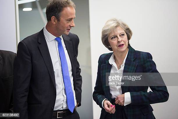 Prime Minister Theresa May speaks with Diabetes UK Chief Executive Chris Askew at the charity's new office on November 14 2016 in London England Mrs...