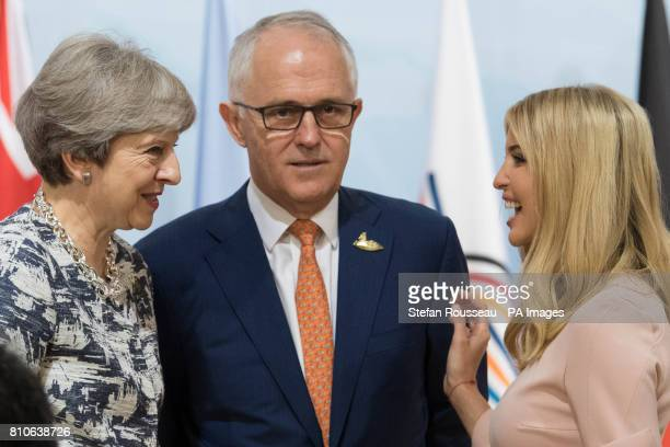 Prime Minister Theresa May talks with Ivanka Trump and Australian Prime Minister Malcolm Turnbull at the launch of the World Bank's Women's...