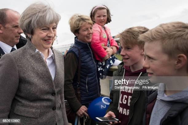 Prime Minister Theresa May visiting the Balmoral Show near Lisburn in Northern Ireland where she toured the exhibition stands and met visitors as...
