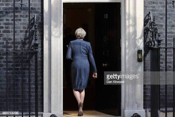 Prime Minister Theresa May walks back into 10 Downing Street after making a statement to the nation on April 18 2017 in London United Kingdom The...